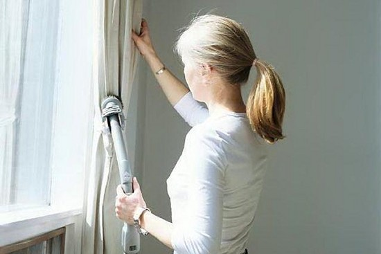 Woman Cleaning Curtains